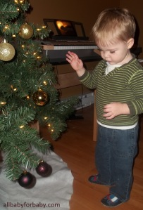 Christmas tree decorating with baby